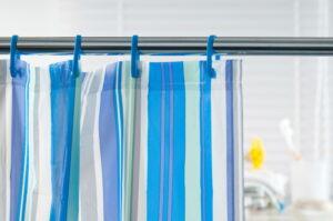 Blue shower curtain in the bathroom